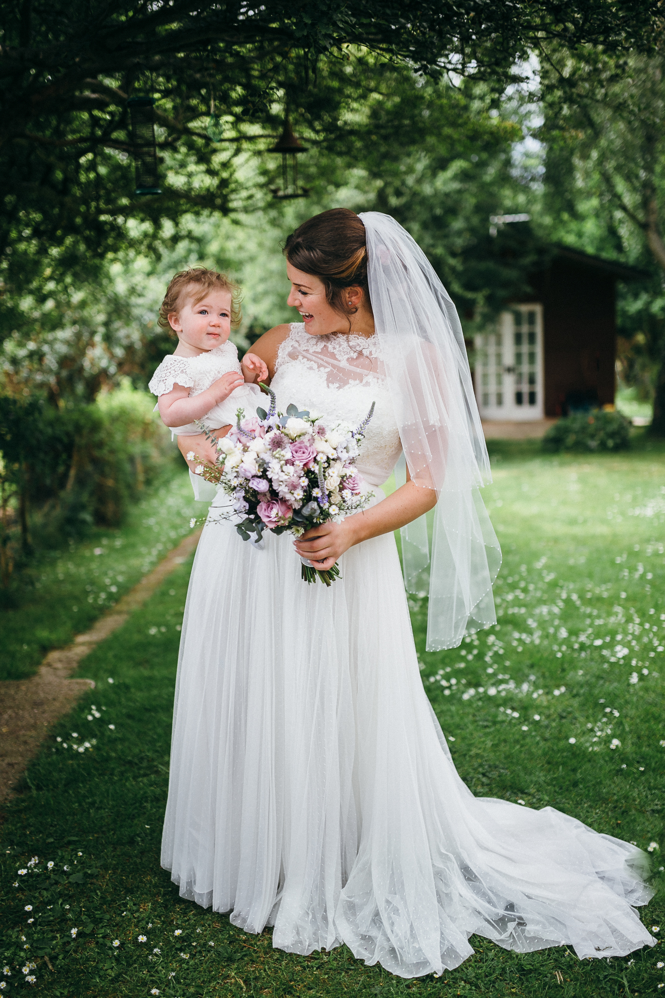 boho dress colorful rustic and vintage tipi wedding photography in surrey bride and daughter