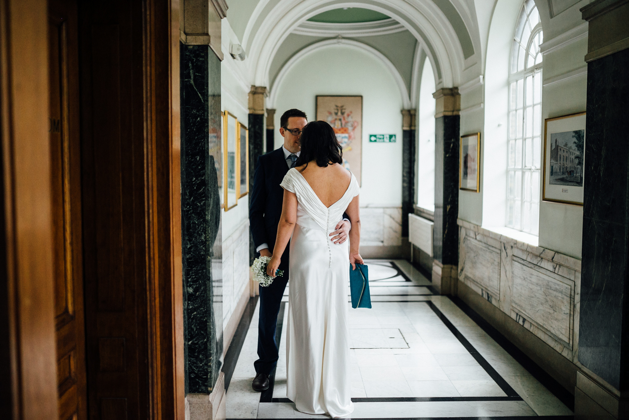 wedding photographer in london islington town hall - first look between bride and groom bridal prep