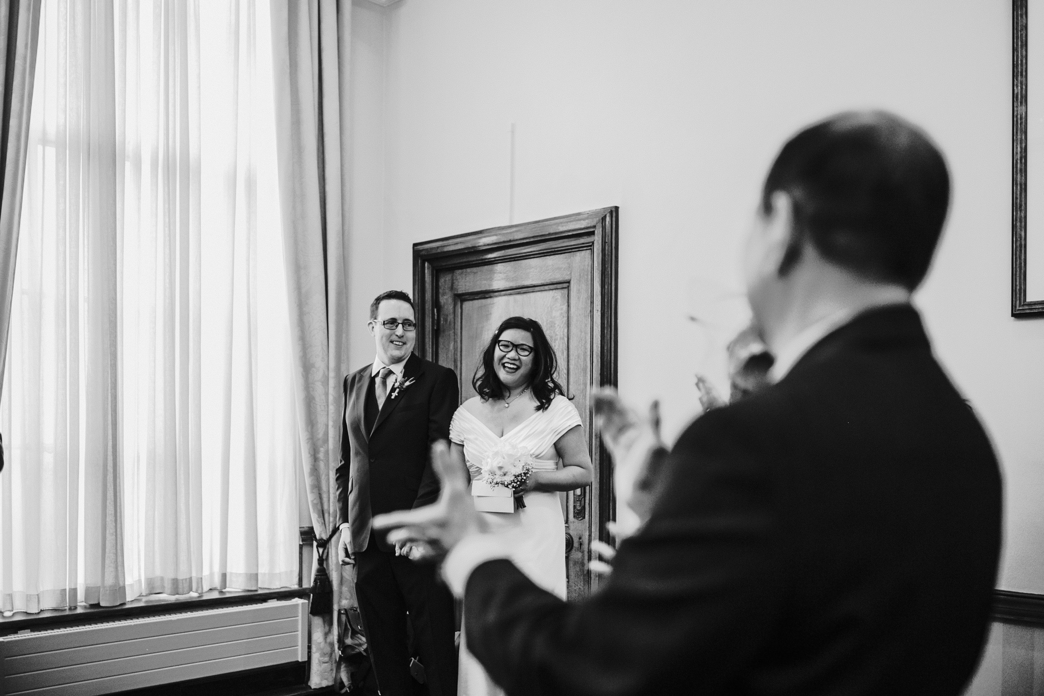 wedding photographer in london islington town hall - first look between bride and groom ceremony photos