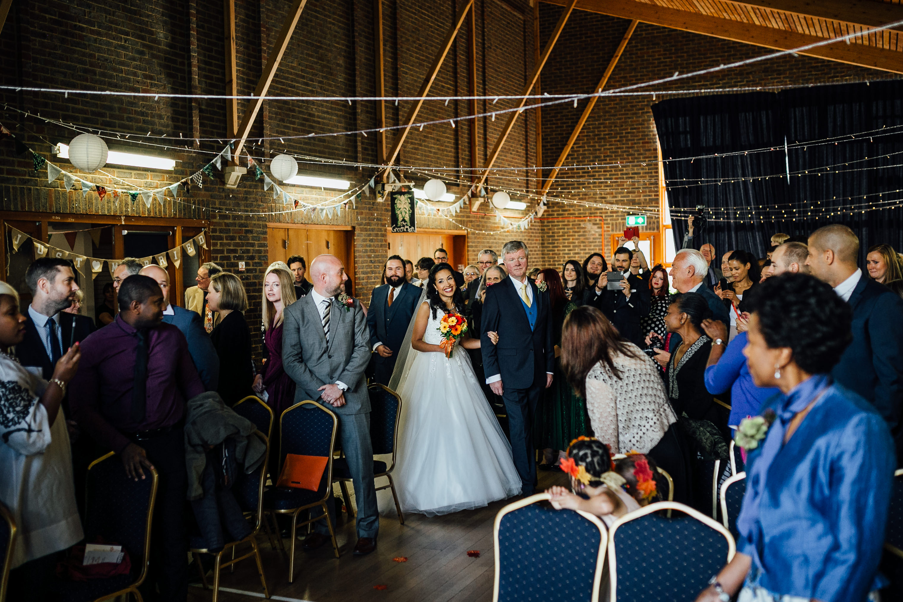 fun quirky autumn wedding in london wedding photographer bride entrance ceremony