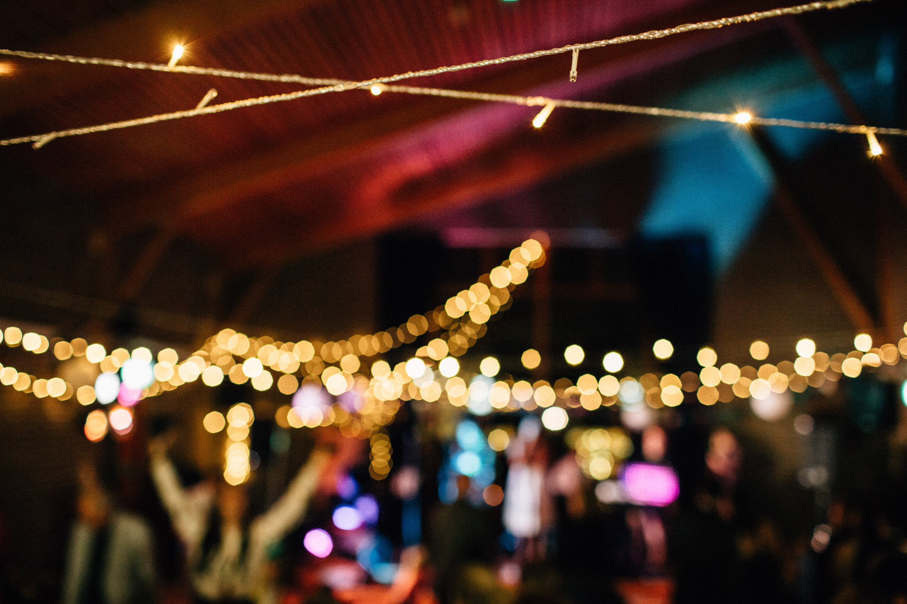 quirky fun autumn wedding in london wedding photographer documentary style first dance fairy lights decoration