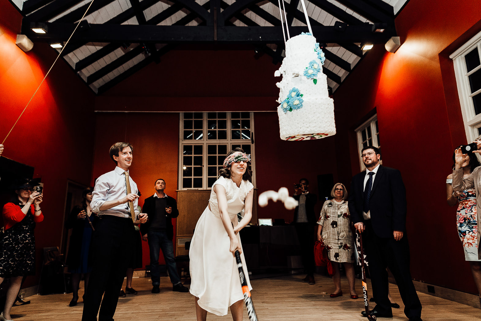 bride and groom smashing pinata cake in london