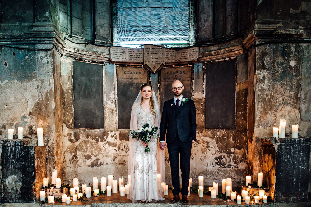bride and groom standing at the asylum chapel ceremony