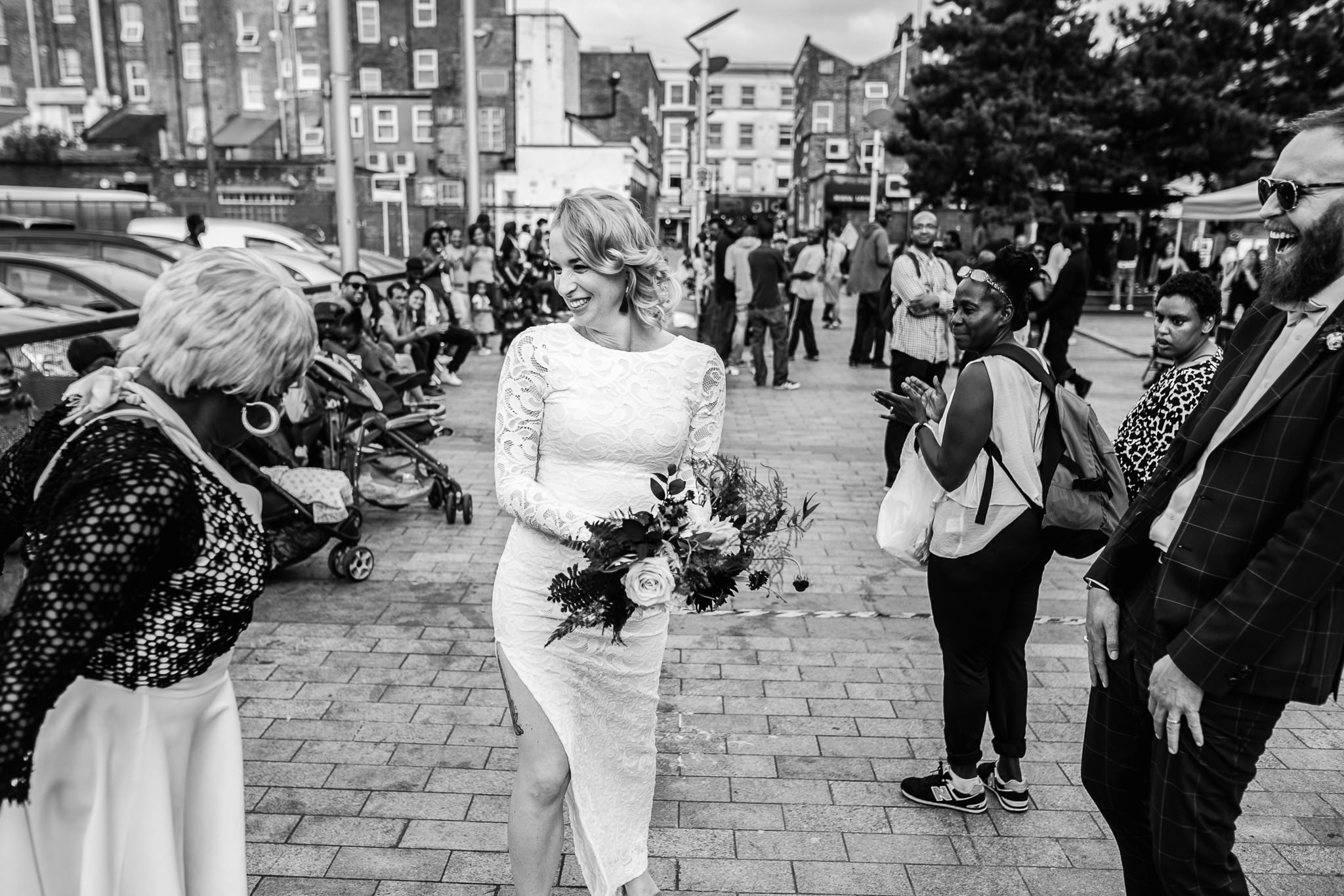 bride and groom during notting hill carnival