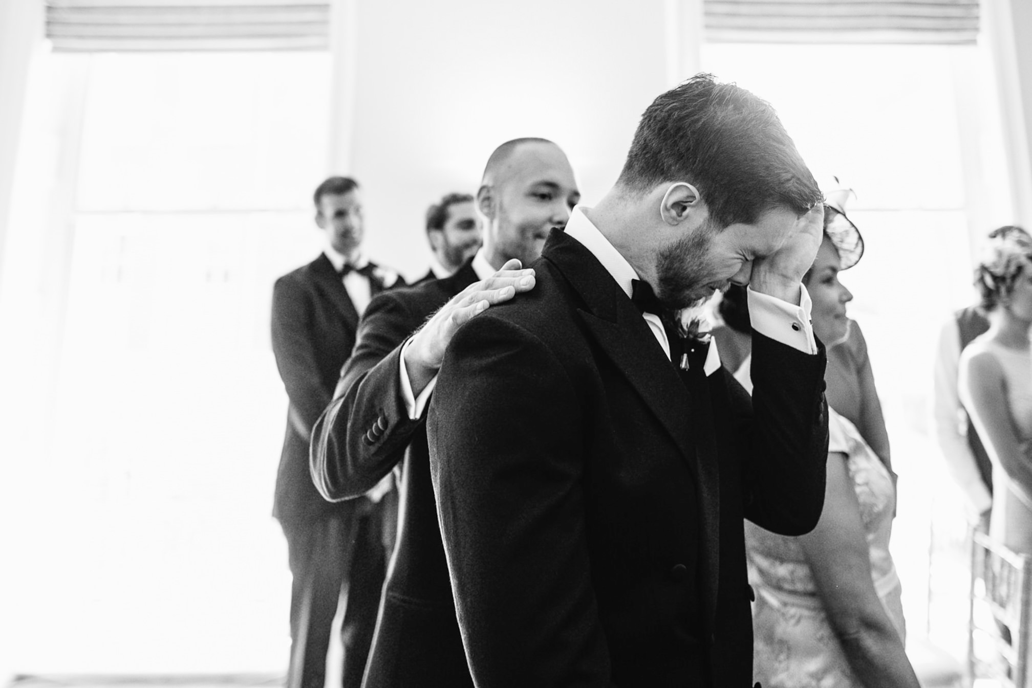 groom crying during ceremony asia house