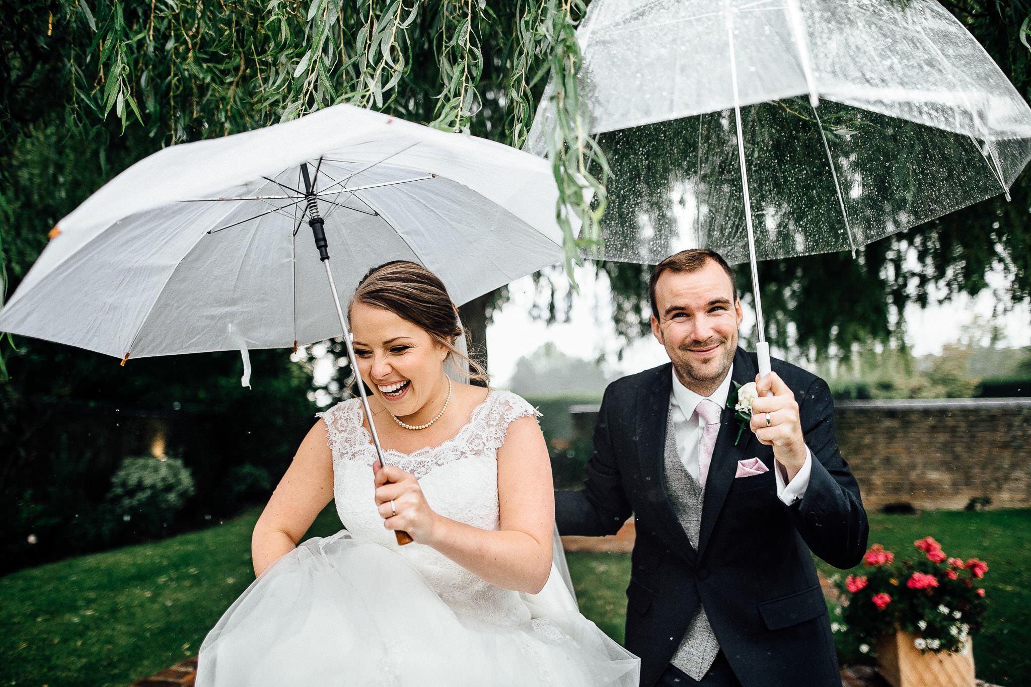 camden town wedding photos bride and groom in the rain