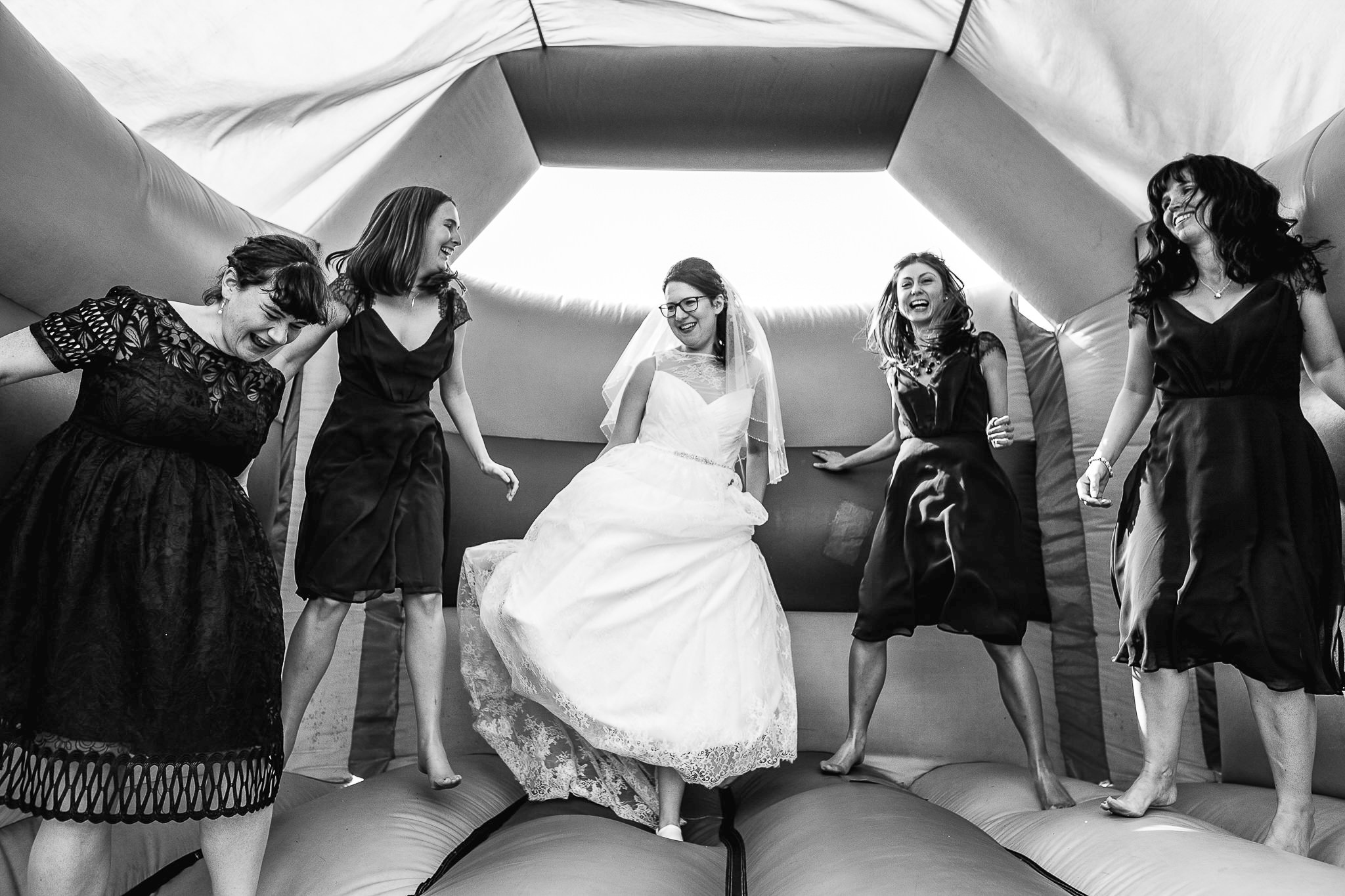bridemaids in bouncy castle at wddings