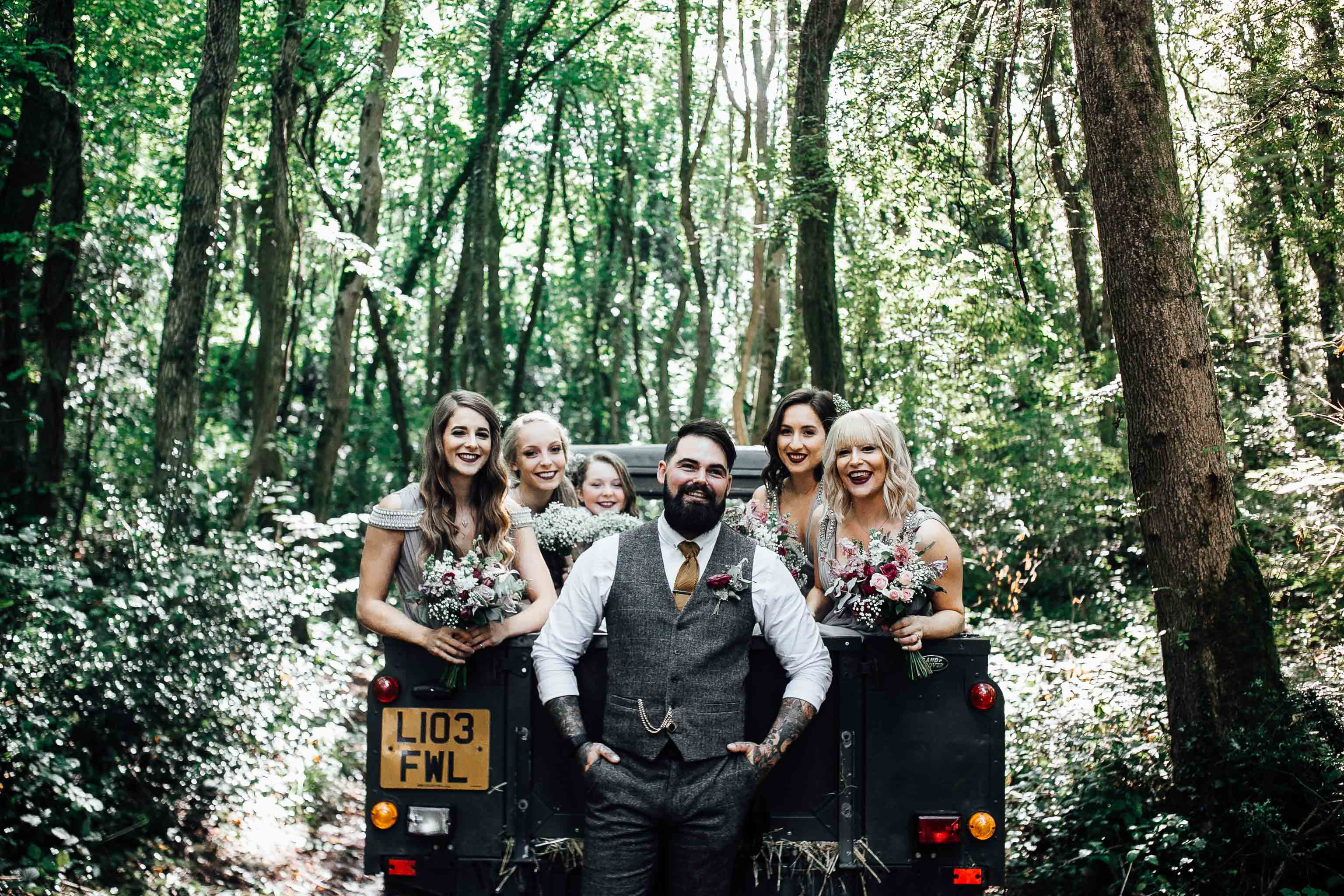 bridal party on a truck wedding transport rain